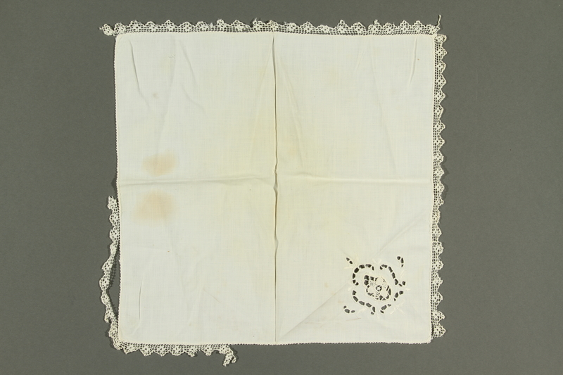 2018.258.3 back Lace-trimmed Handkerchief with a cutwork floral accent owned by a Jewish Austrian refugee