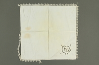 2018.258.3 back Lace-trimmed Handkerchief with a cutwork floral accent owned by a Jewish Austrian refugee  Click to enlarge