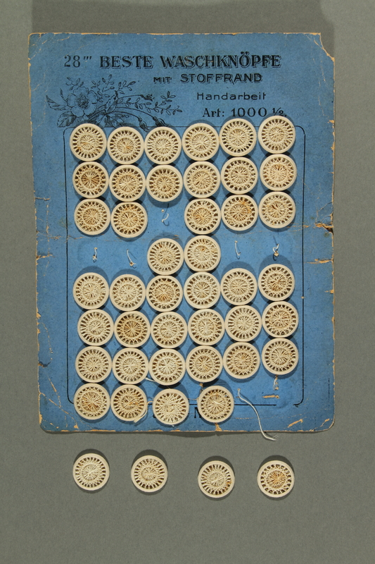 2018.258.8 a-e front Card with 46 Dorset-style buttons owned by a Jewish Austrian refugee