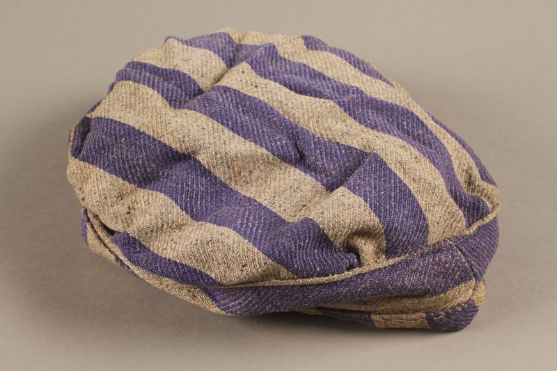 2014.557.5 side a Concentration camp uniform cap worn by a Polish Jewish prisoner who was in several camps