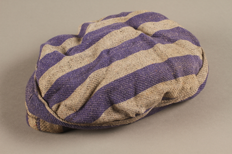 2014.557.5 side b Concentration camp uniform cap worn by a Polish Jewish prisoner who was in several camps