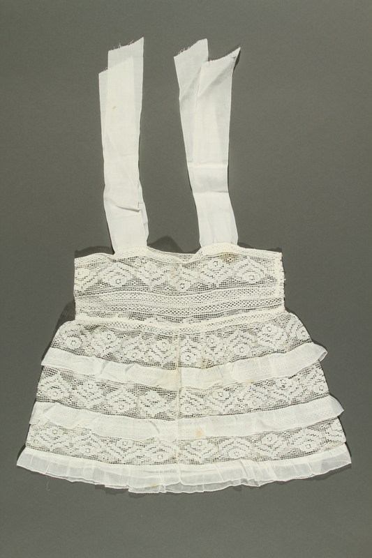 2018.281.2 side A Lace dress worn by a Jewish baby in Yugoslavia before and during the Holocaust