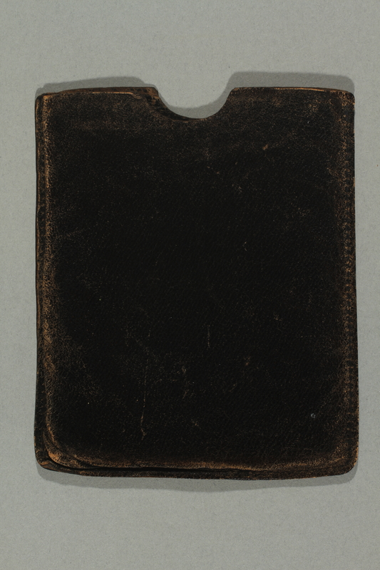 2015.533.2 side b Identification case used by a German Jewish boy while on a refugee transport