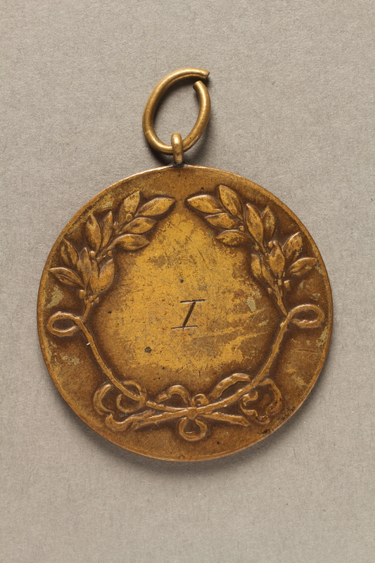 2018.286.3 back Medallion awarded to a Hungarian Jewish athlete