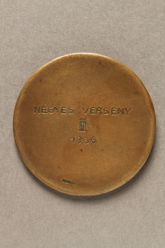2018.286.4 back Medallion from the Financial Institutions Sports Union League awarded to a Hungarian Jewish athlete