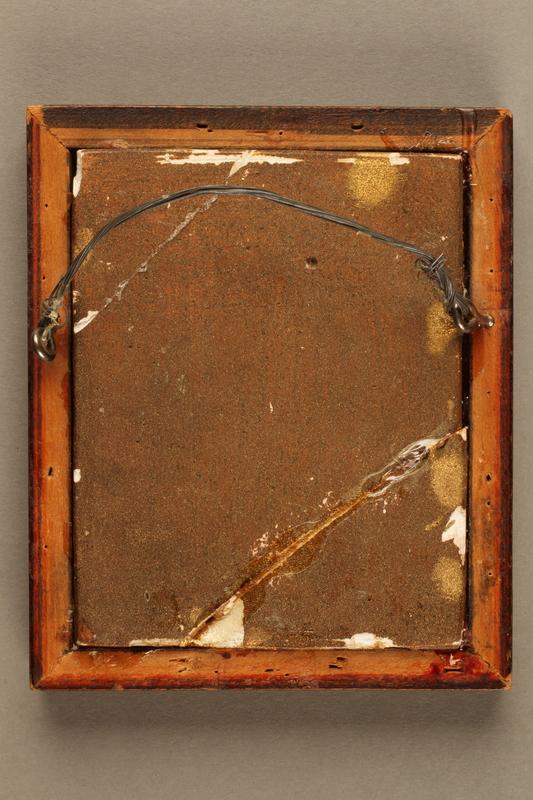 2018.286.5 back Framed, gold-colored plaque depicting a Jewish Hungarian banker