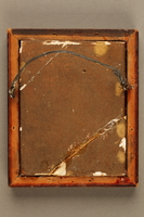 2018.286.5 back Framed, gold-colored plaque depicting a Jewish Hungarian banker  Click to enlarge