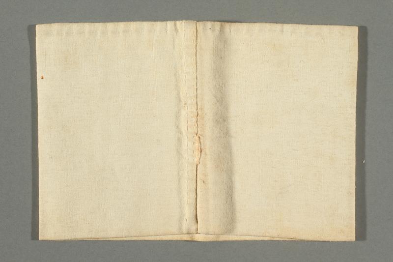 2018.337.4 back Armband worn by a Jewish American prisoner in Compiègne internment camp