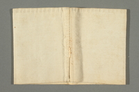 2018.337.4 back Armband worn by a Jewish American prisoner in Compiègne internment camp  Click to enlarge