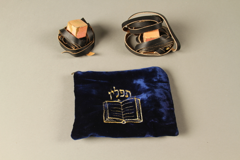 2018.297.3 a-e 3/4 view Pair of tefillin and bag given to a Czechoslovakian Jewish man by a U.S. Army chaplain