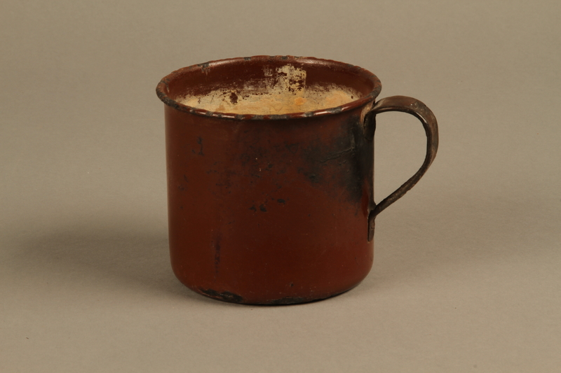 2018.369.4 side a Enameled metal drinking cup used by a Jewish Polish family in a displaced persons camp