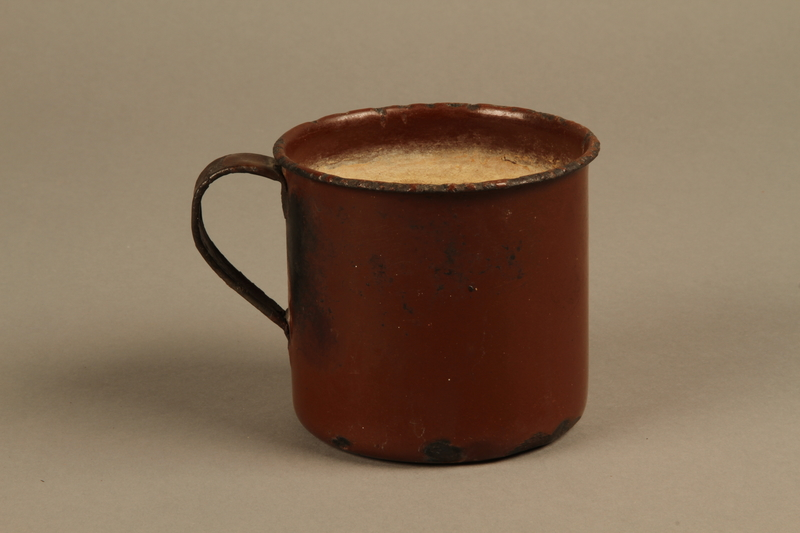 2018.369.4 side b Enameled metal drinking cup used by a Jewish Polish family in a displaced persons camp