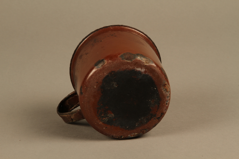 2018.369.4 bottom Enameled metal drinking cup used by a Jewish Polish family in a displaced persons camp