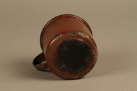 2018.369.4 bottom Enameled metal drinking cup used by a Jewish Polish family in a displaced persons camp  Click to enlarge