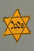 2018.395.2 front Factory-printed Star of David badge acquired by a Polish Jewish refugee and activist  Click to enlarge