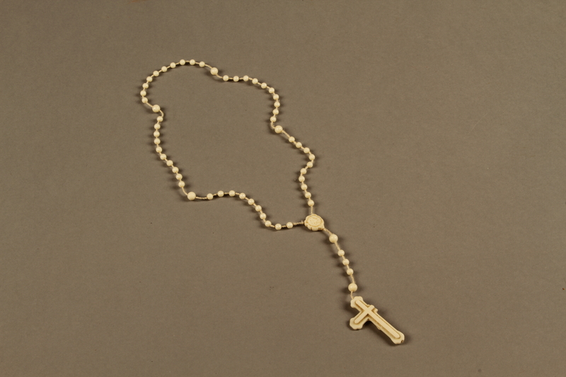 2018.426.4 back Plastic rosary used by an American internee