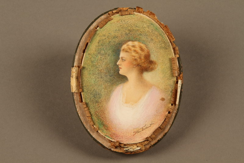 2018.426.8 a front Framed portrait of a woman owned by an American internee