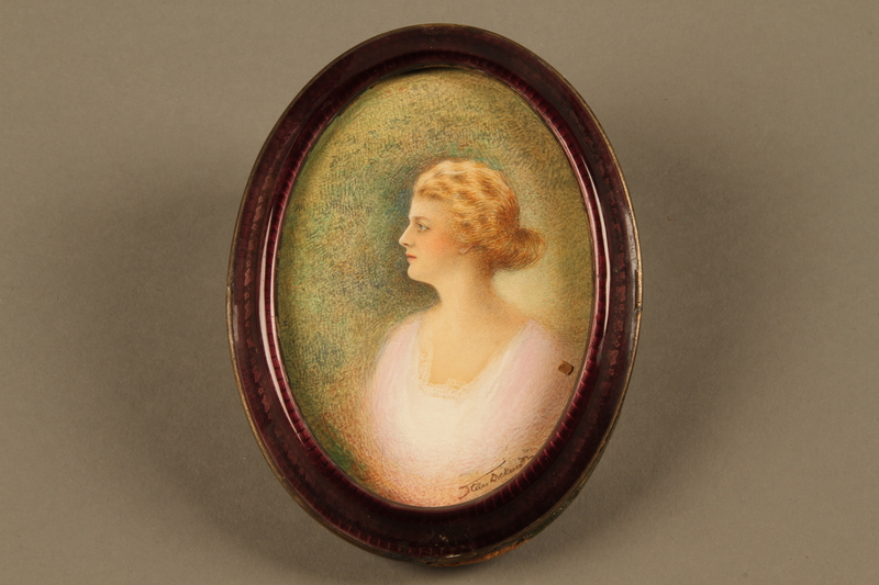 2018.426.8 a-b front Framed portrait of a woman owned by an American internee
