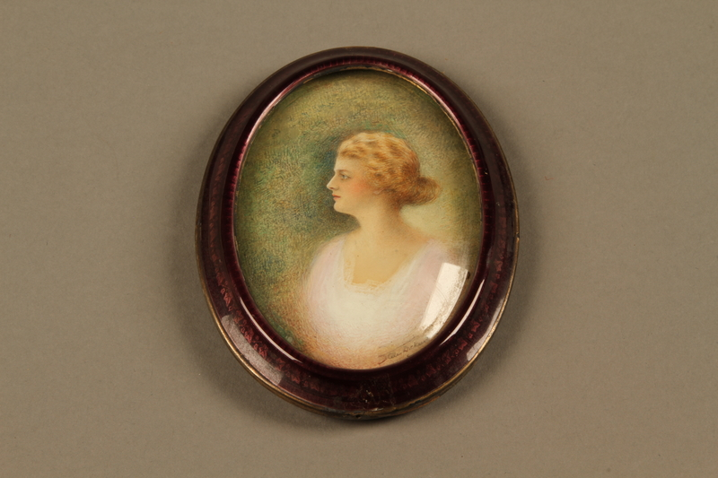 2018.426.8 a-c front Framed portrait of a woman owned by an American internee