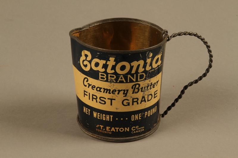 2018.426.9 side a Pitcher made from an Eatonia Brand butter can and used by an American internee