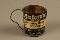 2018.426.9 side b Pitcher made from an Eatonia Brand butter can and used by an American internee  Click to enlarge