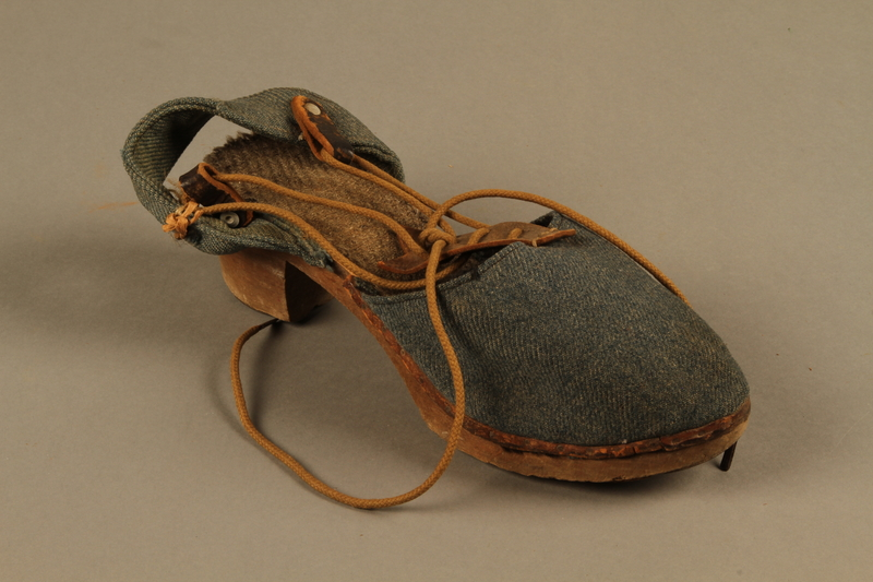 2018.426.12 b 3/4 view Women's blue cloth and wood sandals worn by an American internee