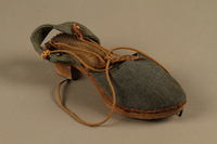 2018.426.12 b 3/4 view Women's blue cloth and wood sandals worn by an American internee  Click to enlarge