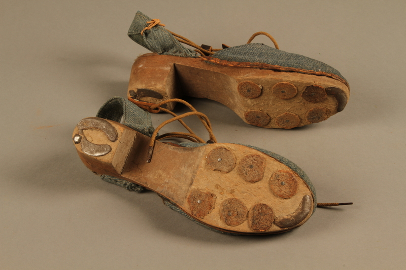 2018.426.12 a-b bottom Women's blue cloth and wood sandals worn by an American internee