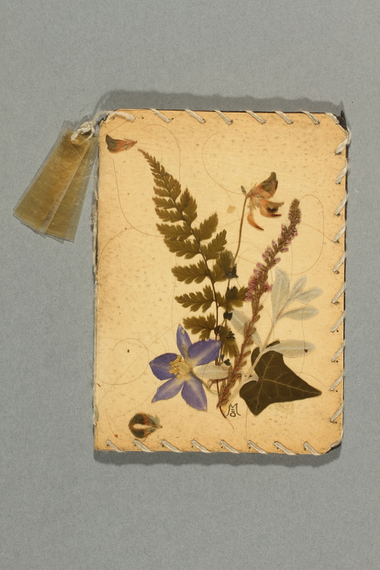 2012.443.6 front Notebook with pressed flower cover