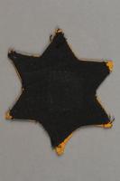 2018.427.4 back Factory-printed Star of David badge printed with Jude, belonging to a German Jewish prisoner  Click to enlarge