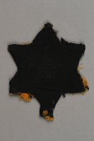 2018.427.5 back Factory-printed Star of David badge printed with Jude, worn by a German Jewish prisoner  Click to enlarge
