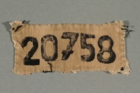 2009.413.2 front Cloth badge with the number 20758  Click to enlarge