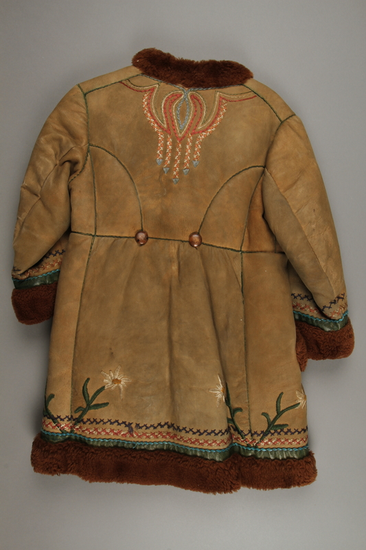 2018.498.1 back Child's coat purchased by a Polish Jewish soldier in the Soviet army for his daughter