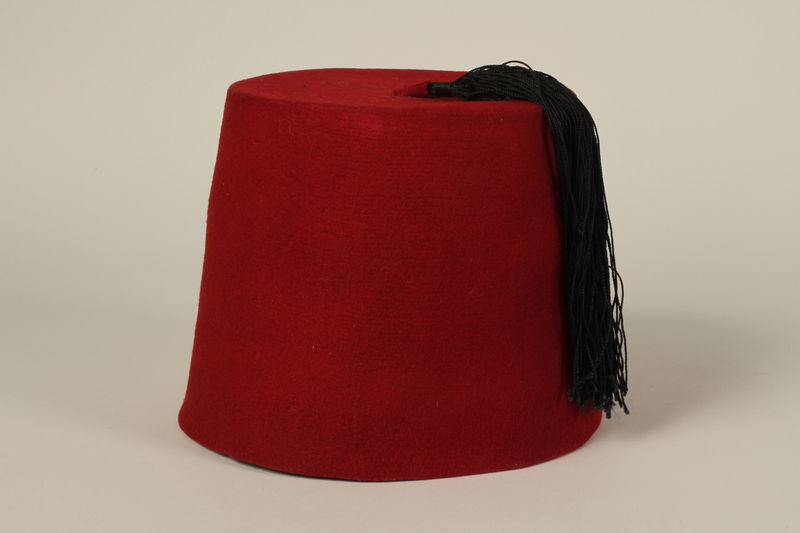 1992.212.1 front Red fez found at Dachau concentration camp after liberation