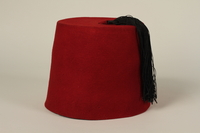 1992.212.1 front Red fez found at Dachau concentration camp after liberation  Click to enlarge