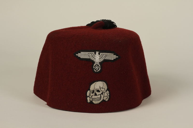 1992.212.2 front Waffen SS red fez found at Dachau concentration camp after liberation