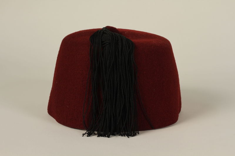 1992.212.2 back Waffen SS red fez found at Dachau concentration camp after liberation