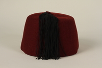 1992.212.2 back Waffen SS red fez found at Dachau concentration camp after liberation  Click to enlarge