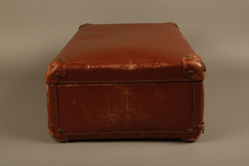 2018.613.7 left Vulcanized fiber suitcase owned by a member of the Frank family