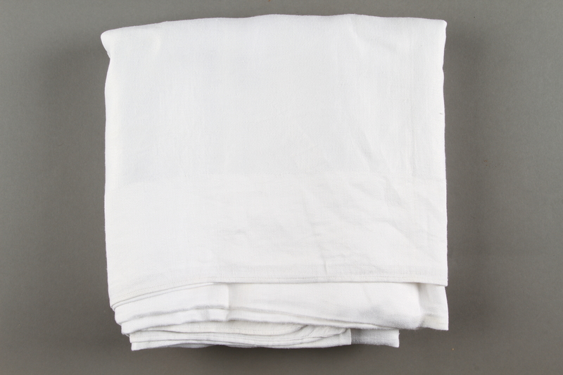 2018.613.5 side a Monogrammed tablecloth owned by Otto and Edith Frank