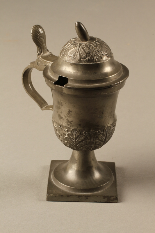 2018.613.4 side a Pewter mustard pot owned by Otto Frank