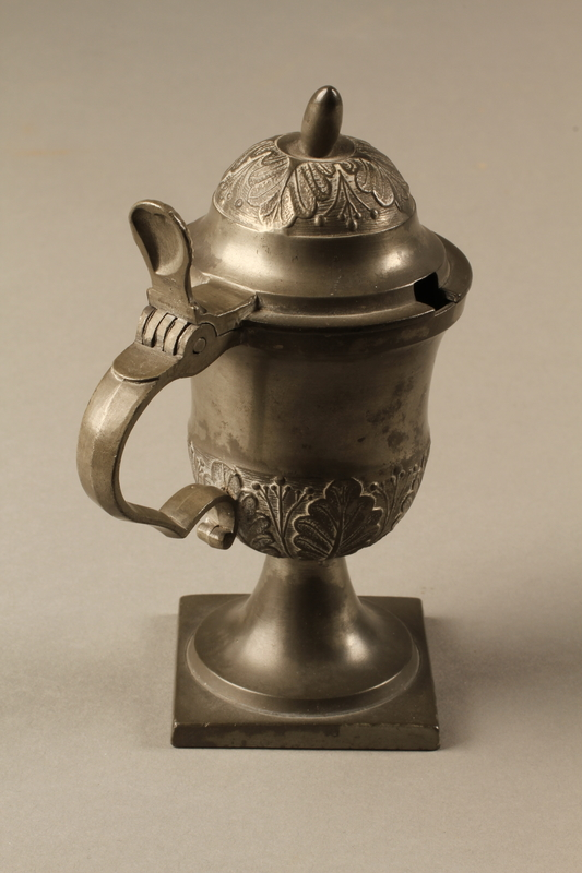 2018.613.4 side d Pewter mustard pot owned by Otto Frank