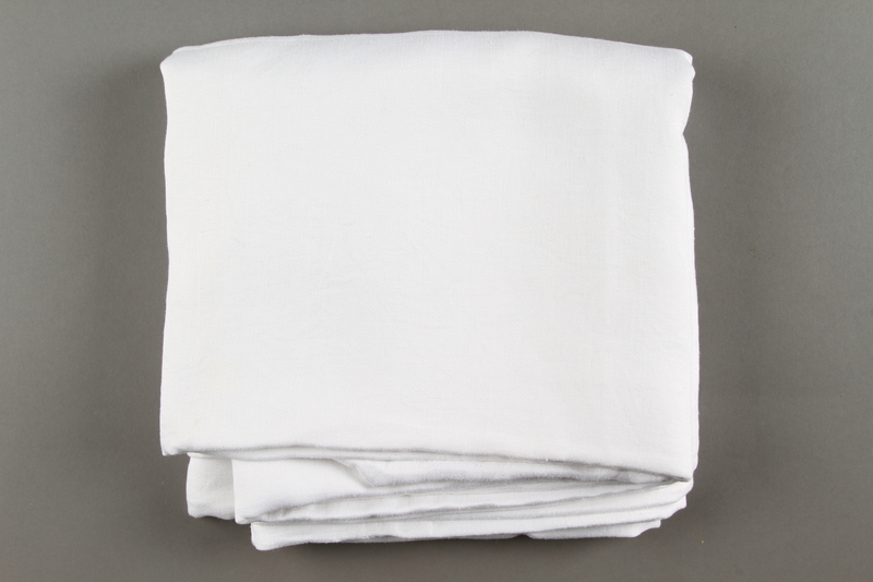 2018.613.5 side b Monogrammed napkin owned by Otto and Edith Frank