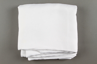 2018.613.5 side b Monogrammed napkin owned by Otto and Edith Frank  Click to enlarge