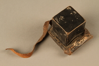 2006.516.5 a side a Pair of Tefillin and pouch owned by a Romanian Jewish concentration camp survivor  Click to enlarge