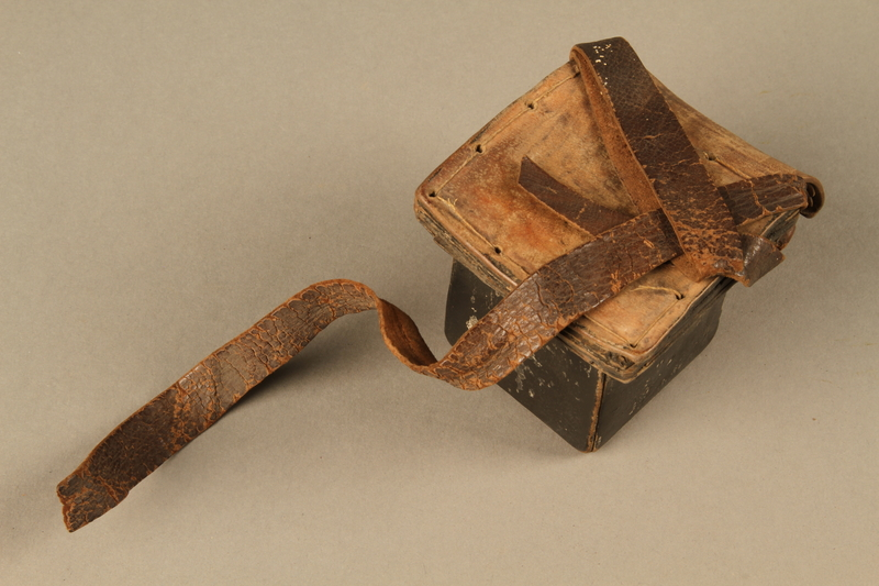 2006.516.5 a side b Pair of Tefillin and pouch owned by a Romanian Jewish concentration camp survivor