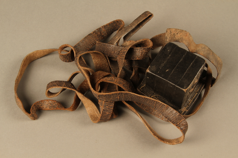 2006.516.5 b side a Pair of Tefillin and pouch owned by a Romanian Jewish concentration camp survivor