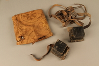 2006.516.5 a-c front Pair of Tefillin and pouch owned by a Romanian Jewish concentration camp survivor  Click to enlarge