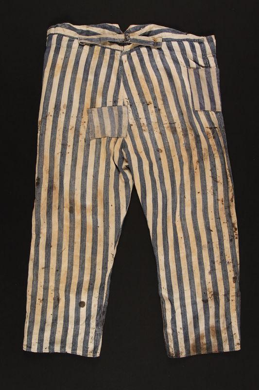 1992.236.2 back Concentration camp uniform pants worn by a prisoner
