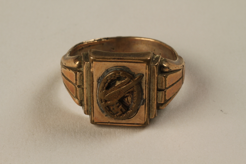 1992.24.1 front Nazi unit men's brass finger ring found by a US soldier